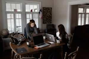 Two women writing guest blog posts.