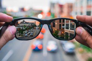 City showing through sunglasses.