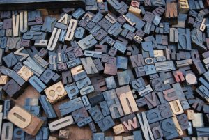 Letters of the alphabet scattered on the table.