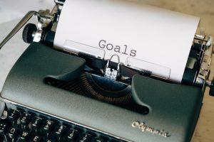 Goals written on typewriter.