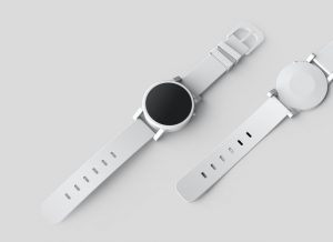 A white watch on a white table.