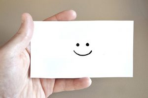 Smiley on a paper.